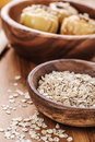 Oat flakes in bowl on wooden table Royalty Free Stock Photos