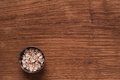 Oat flakes in metal bowl on brown wooden table Royalty Free Stock Photo