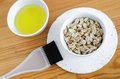 Oat flakes and olive oil in a small ceramic bowls for preparing natural masks and scrubs. Ingredients for homemade cosmetics. Royalty Free Stock Photo