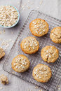 Oat muffins, apple, banana cakes on a cooling rack Royalty Free Stock Photo