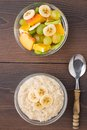 Oat porridge and fruits on a wooden table Royalty Free Stock Image