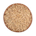 Oat seeds in a wooden bowl on white background Stock Images