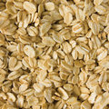 Oatmeal background rolled raw oats macro closeup Stock Images