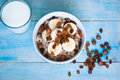 Oatmeal with bananas and raisins healthy breakfast a glass of milk Royalty Free Stock Images