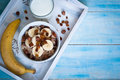 Oatmeal with bananas and raisins healthy breakfast a glass of milk Stock Images