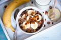 Oatmeal with bananas raisins and honey healthy breakfast a glass of milk Stock Photography