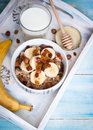 Oatmeal with bananas raisins and honey healthy breakfast a glass of milk Royalty Free Stock Image
