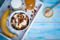 Oatmeal with bananas raisins and honey healthy breakfast a glass of milk Royalty Free Stock Photos