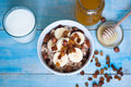 Oatmeal with bananas raisins and honey healthy breakfast a glass of milk Stock Photos