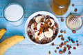 Oatmeal with bananas raisins and honey healthy breakfast a glass of milk Stock Image