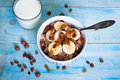 Oatmeal with bananas raisins and honey healthy breakfast a glass of milk Royalty Free Stock Photo
