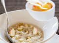 Oatmeal breakfast in modern white bowl Stock Image