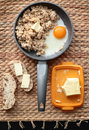 Oatmeal breakfast with scrambled eggs and bread and butter Royalty Free Stock Photo