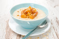 Oatmeal with caramelized peaches in a bowl close up horizontal Stock Photography