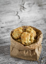 Oatmeal cookies with apples in a paper bag Royalty Free Stock Photo