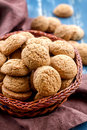 Oatmeal cookies in a basket on a wooden table Royalty Free Stock Photo