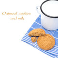 Oatmeal cookies and enamel mug of milk isolated on white Royalty Free Stock Photo