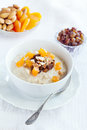Oatmeal with dried fruit and nuts Stock Photo