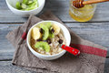 Oatmeal with fruit in a bowl food Stock Images