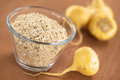 Oatmeal mixed with maca powder or peruvian ginseng lat lepidium meyenii fresh roots around selective focus focus one third into Royalty Free Stock Photos