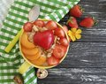 oatmeal, nuts, strawberry, apricot, heart on a black wooden background Royalty Free Stock Photo