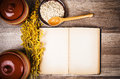Oatmeal and an old recipe book on the kitchen table close up Stock Photography