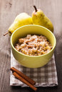 Oatmeal with pears slices Stock Images