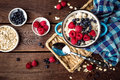 Oatmeal porridge with fresh berries, oats with blueberry and raspberry Royalty Free Stock Photo