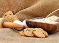 Oatmeal Raisin Cookies on a  burlap background. Royalty Free Stock Photo