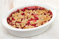 Oatmeal strawberry crumble in white dish on white background Royalty Free Stock Photo