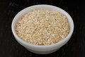 Oatmeal in white bowl on dark background Royalty Free Stock Image
