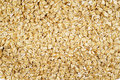 Oats background uncooked rolled as texture Royalty Free Stock Image
