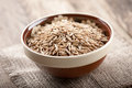 Oats raw in ceramic bowl Royalty Free Stock Images