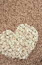 Oats seeds and oat-flakes heart Stock Photography