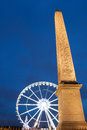 Obelisk of Luxor and big wheel, Concordia square, Paris Royalty Free Stock Photo
