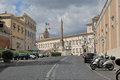 Obelisk and parked vehicles in piazza del quirinale in rome italy august view on Royalty Free Stock Image