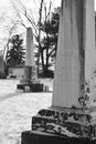 Obelisk tombstones in winter two are pictured black and white an old cemetery the one the foreground is focus but the Stock Photos