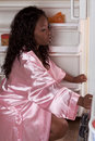 Obese black woman get to fridge for late snack Royalty Free Stock Images