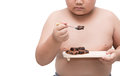 Obese fat boy eat nama chocolate isolated on white Royalty Free Stock Photo