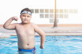 Obese fat boy swimming pool. Royalty Free Stock Photo