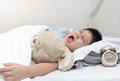 Obese fat boy yawn and sleep in morning Royalty Free Stock Photo