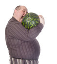 Obese man biting a watermelon Royalty Free Stock Image