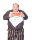 Obese man eating watermelon Royalty Free Stock Photos