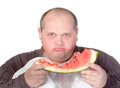 Obese man possessive of his food Royalty Free Stock Images