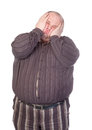 Obese man squashing his face Stock Images