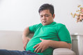 Obese man thinking about his weight problem Royalty Free Stock Photo
