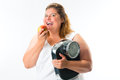 Obese woman with scale under arm and apple diet weight young her Royalty Free Stock Images