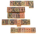 Obesity, heartburn, allergies and asthma Stock Image