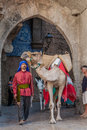 Obidos portugal moorish man with dromedary camel in the parade of the medieval market reenactment august Stock Image