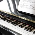 Object in situ color photo close up of a musical note book and a piano Royalty Free Stock Photos